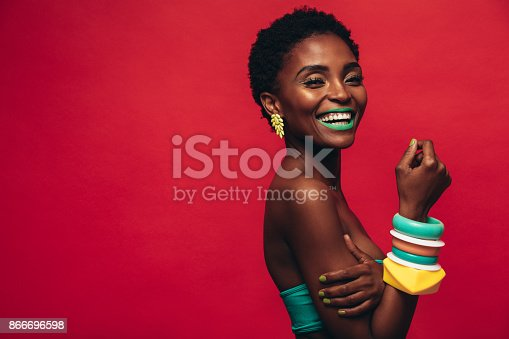 istock Smiling female model with artistic makeup 866696598