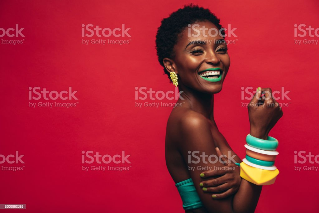 Smiling female model with artistic makeup - foto stock