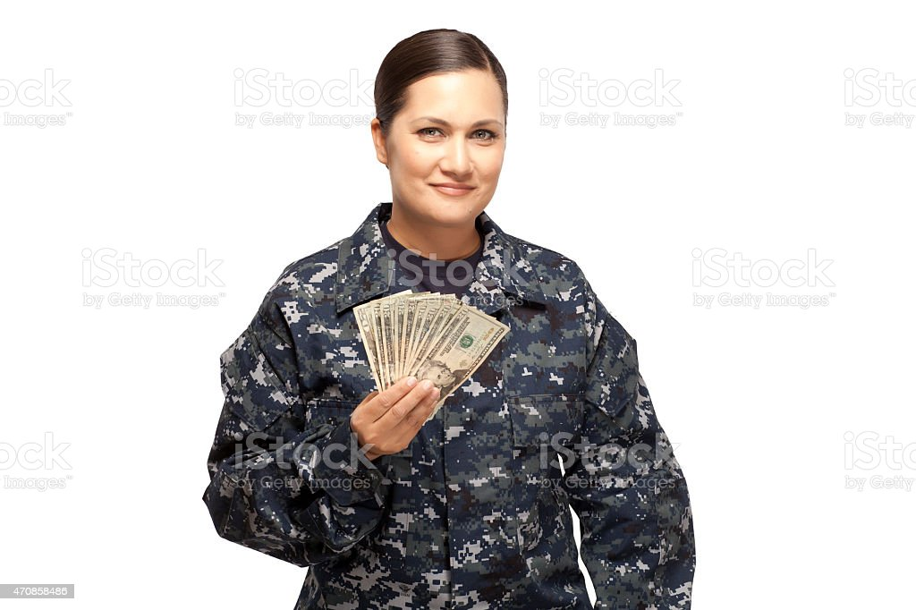 Smiling female navy sailor with money stock photo