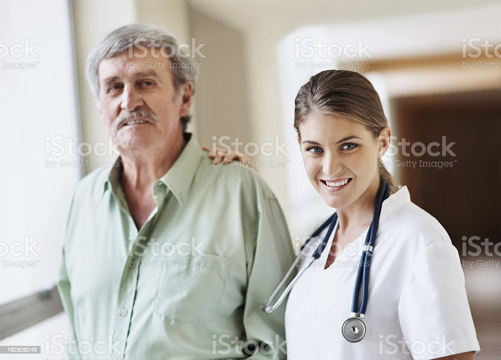 Smiling female nurse with a senior patient royalty-free stock photo
