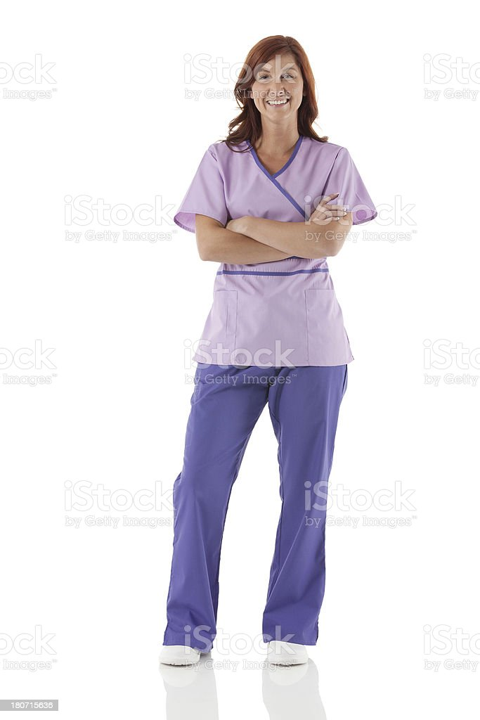 Smiling female nurse with arms crossed royalty-free stock photo