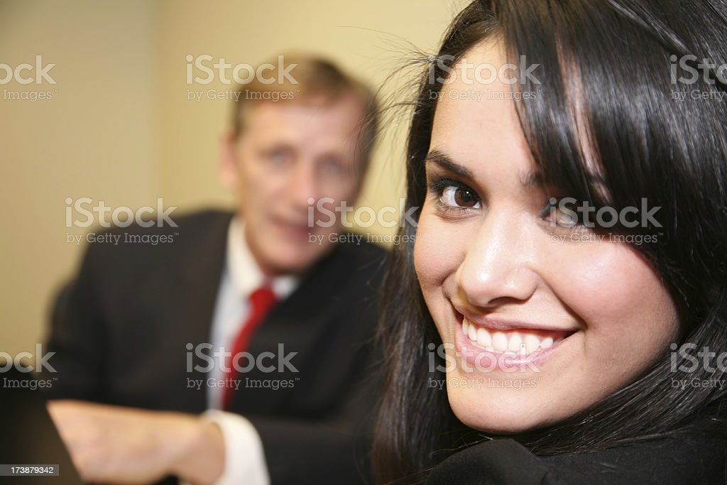 Smiling Female Office Worker and her Boss royalty-free stock photo