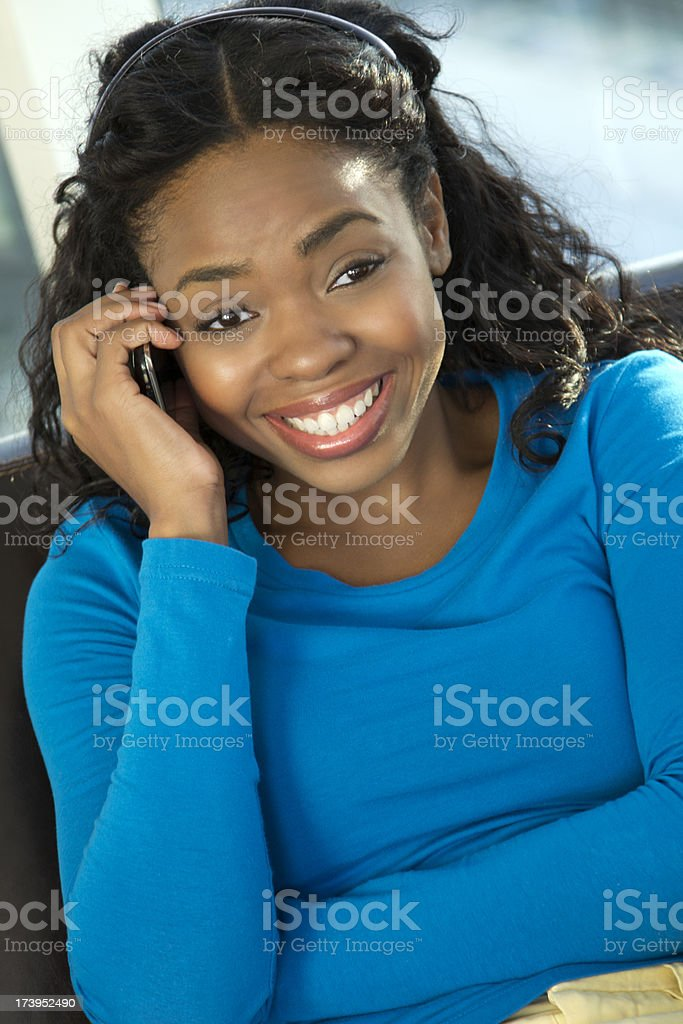 Smiling female on cellphone stock photo