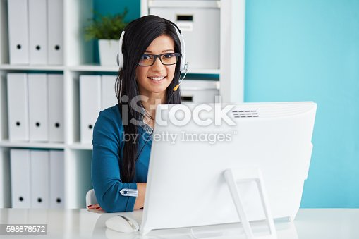 istock Smiling female operator with headset 598678572
