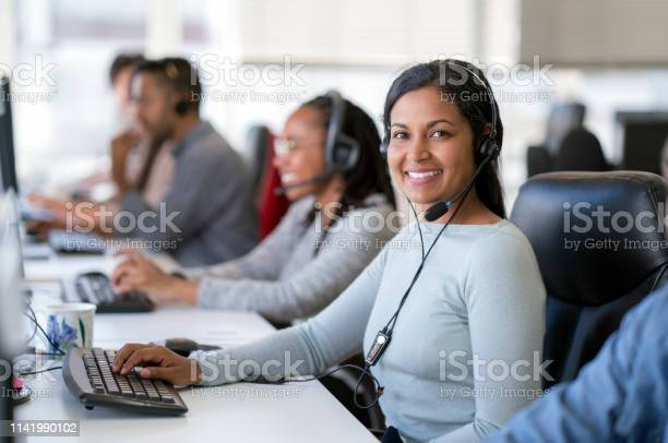 Smiling female operator working in call center picture id1141990102?b=1&k=6&m=1141990102&s=612x612&h=922dwzhj87idgspggj9icm0lersdlikqcwxy6atl0ow=