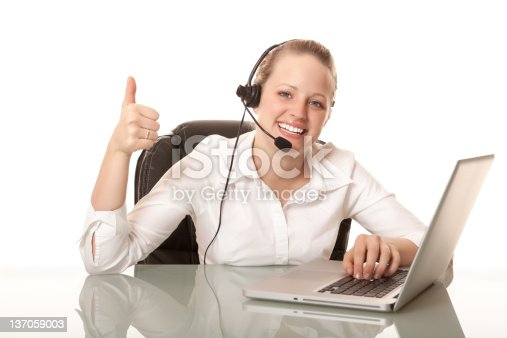 istock Smiling female receptionist with thumbs up 137059003