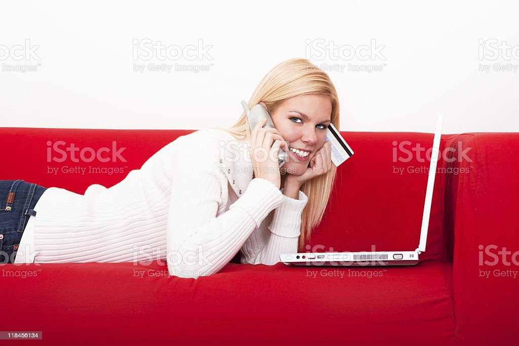 Smiling female shopping online royalty-free stock photo