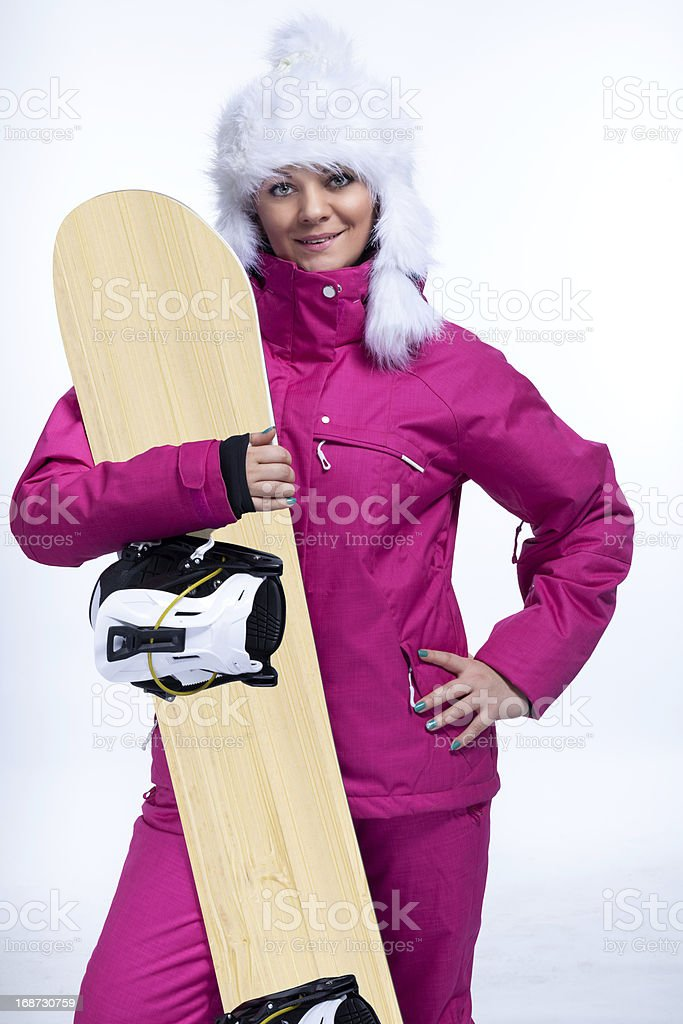 Smiling female snowboarder royalty-free stock photo