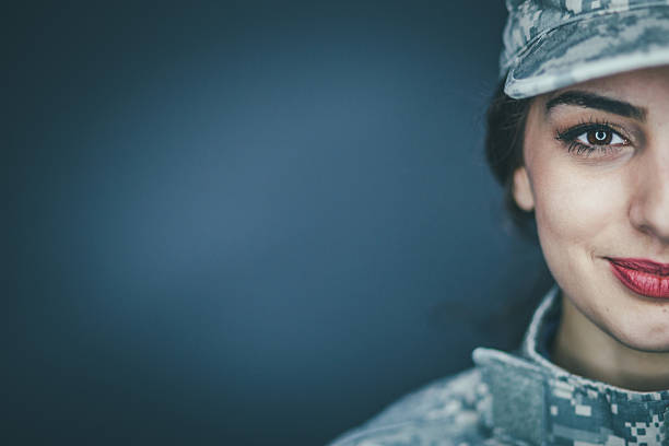 smiling female soldier - armed forces stock photos and pictures