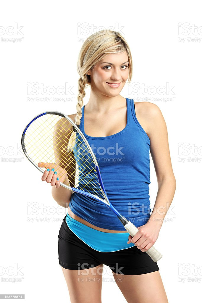 Smiling female squash player posing stock photo