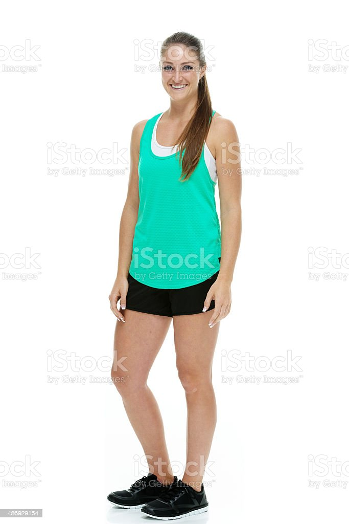 Smiling female standing and looking at camera stock photo