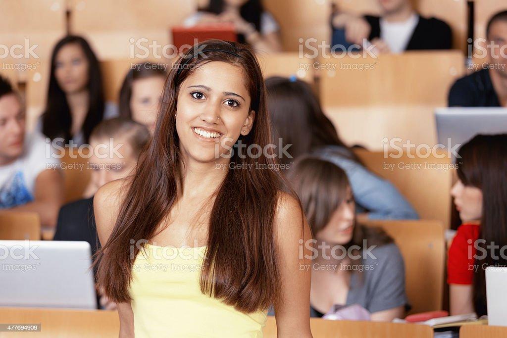 smiling female student auditorium royalty-free stock photo