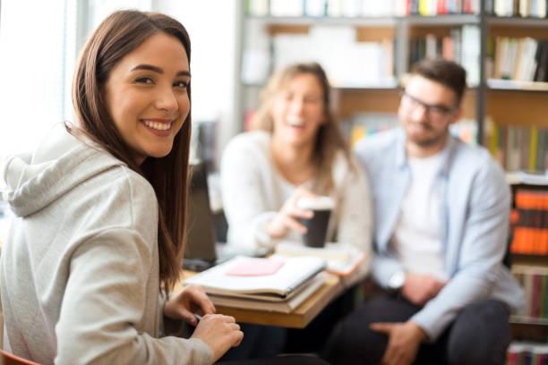 Smiling female student stock photo