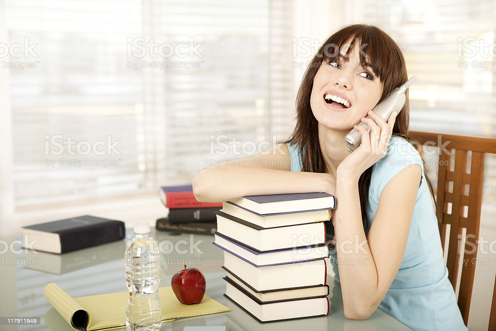 Smiling female student talking on the phone royalty-free stock photo