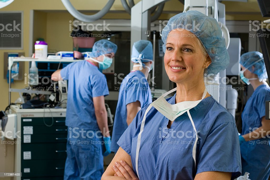 Smiling female surgeon in scrubs royalty-free stock photo