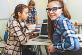istock Smiling female teenager at classroom 639184052