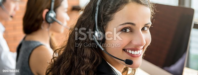 istock Smiling female telemarketing customer service agent woking in call center 999756334