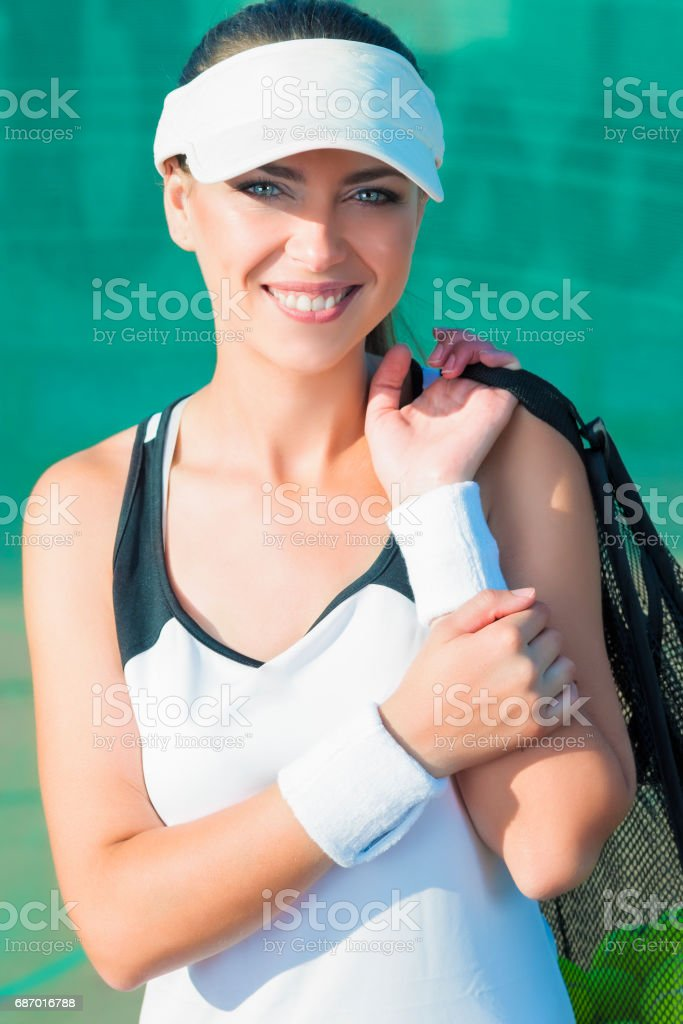 Smiling Female Tennis Woman Holding Tennis Mesh Bag with Balls....