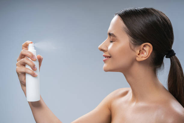 Smiling female with a ponytail doing a beauty procedure stock photo