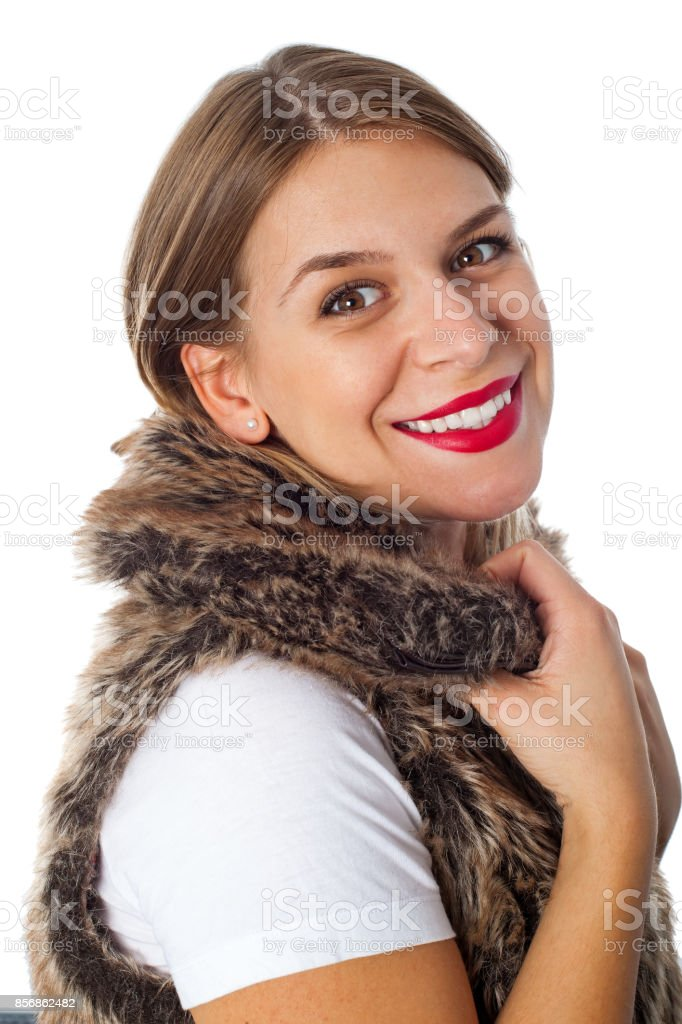 Smiling female with fur vest stock photo