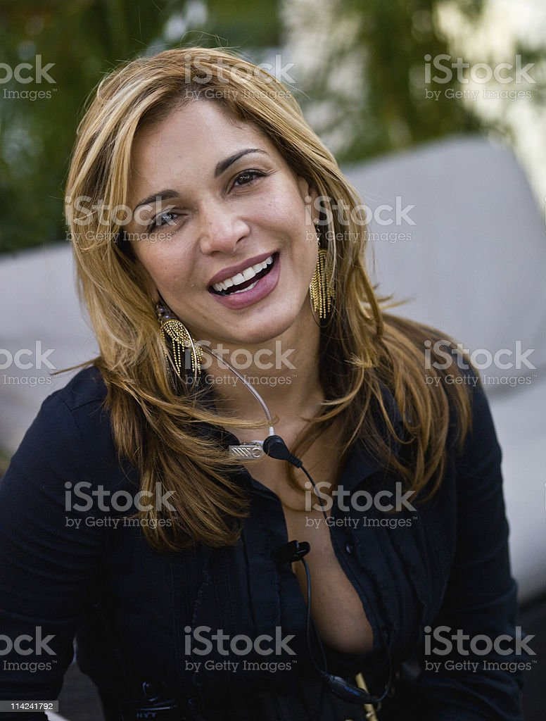 Smiling female with microphone royalty-free stock photo