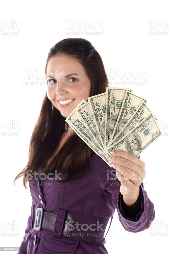 Smiling female with pile of dollar (focus on hand) stock photo