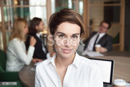 istock Smiling female worker posing for company business catalogue 973971100