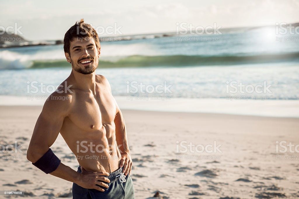 smiling fit man relaxing after workout stock photo