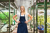 istock Smiling florist standing in marijuana plant 637711566