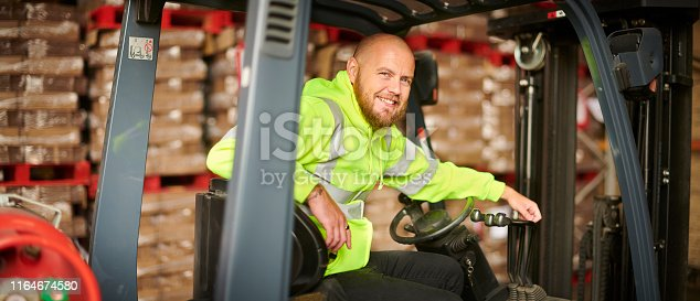 fork lift truck driver in warehouse