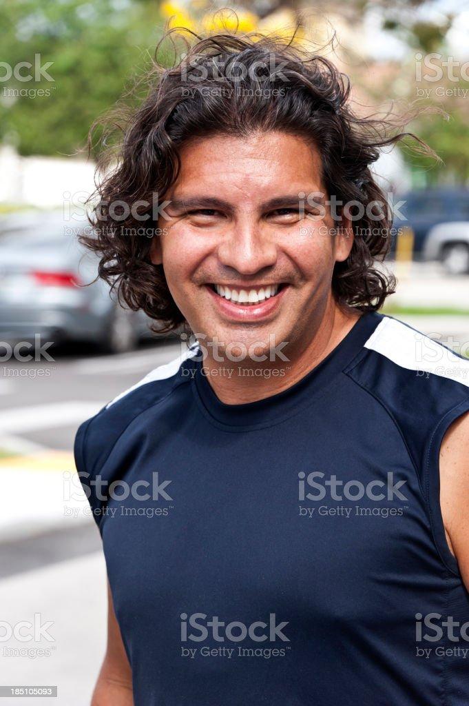 Smiling forty something hispanic man royalty-free stock photo