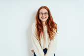 istock Smiling friendly young woman wearing spectacles 1251308867