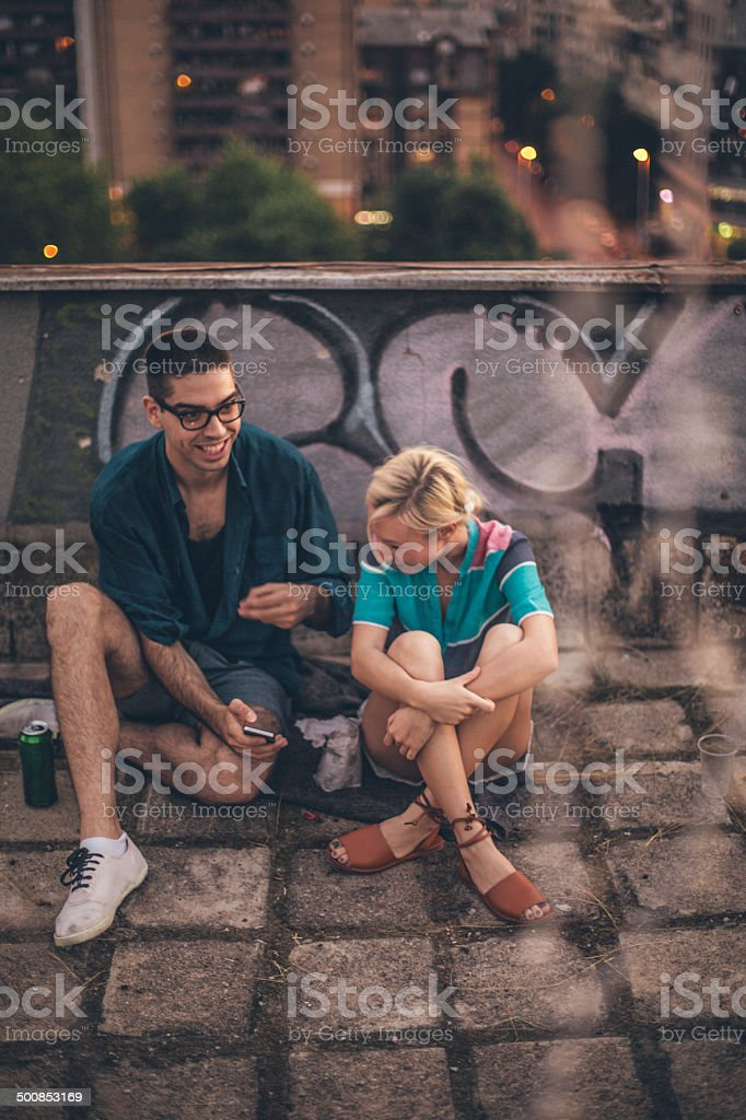 Smiling friends at a rooftop stock photo