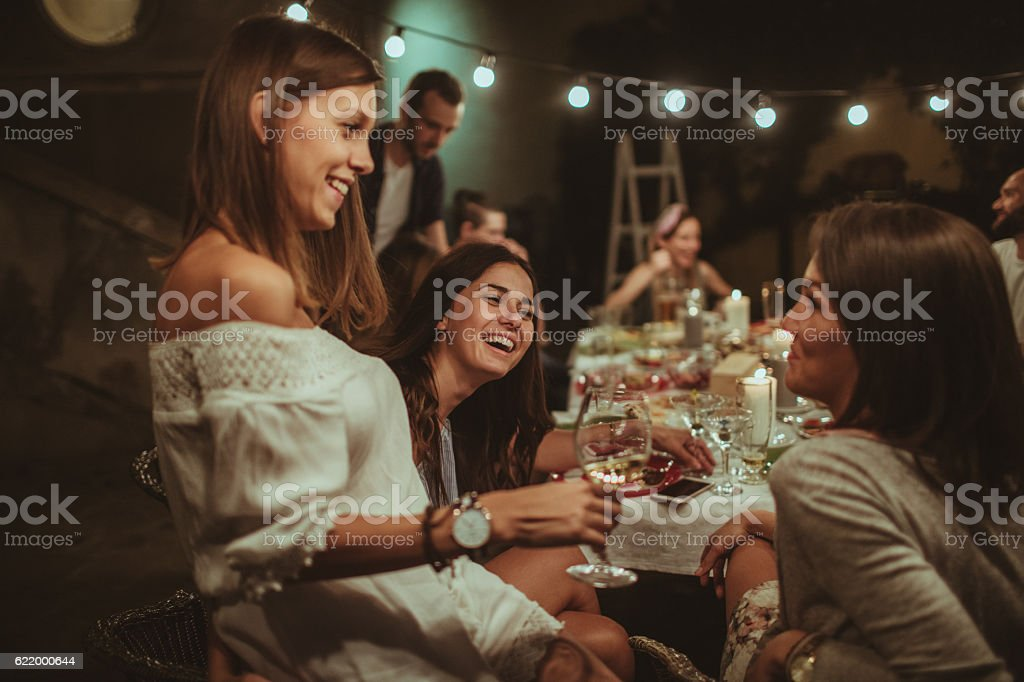 Smiling friends at the dinner party - foto de acervo