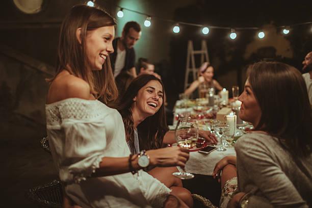 Smiling friends at the dinner party - foto de acervo
