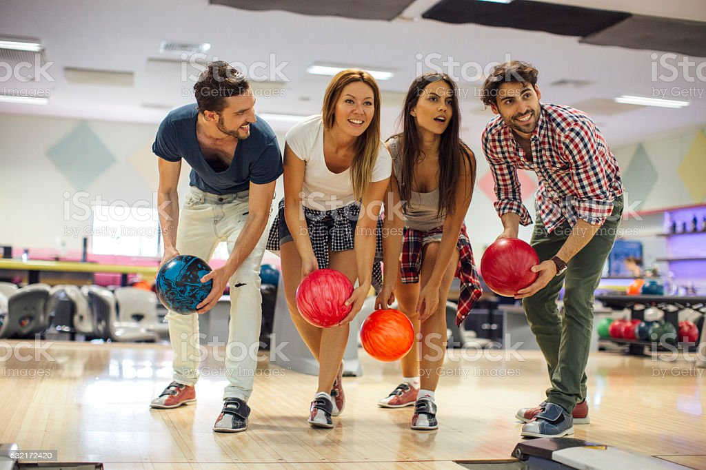 Smiling Friends Bowling Together stock photo