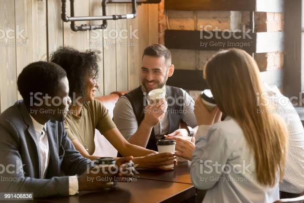 Smiling friends enjoying time together having coffee in cafe picture id991406836?b=1&k=6&m=991406836&s=612x612&h=x5rlir4xq5dgzidzdjfbxyjdmmcqgqpfgvfucfamtwy=