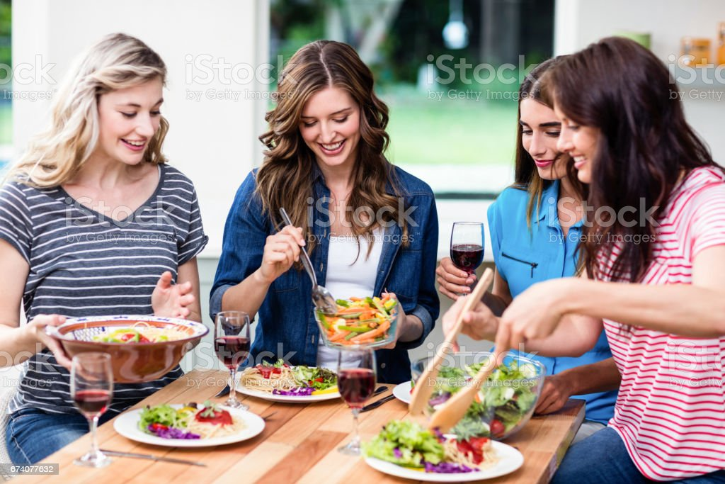 Smiling friends having food foto de stock royalty-free