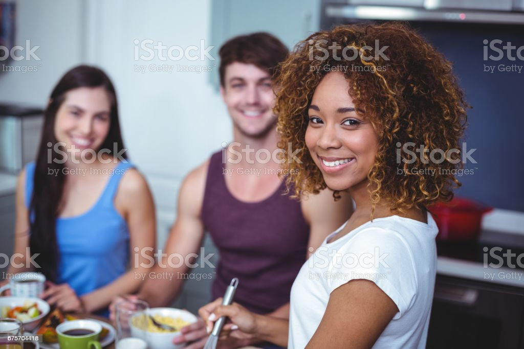 Smiling friends standing at table royalty-free stock photo