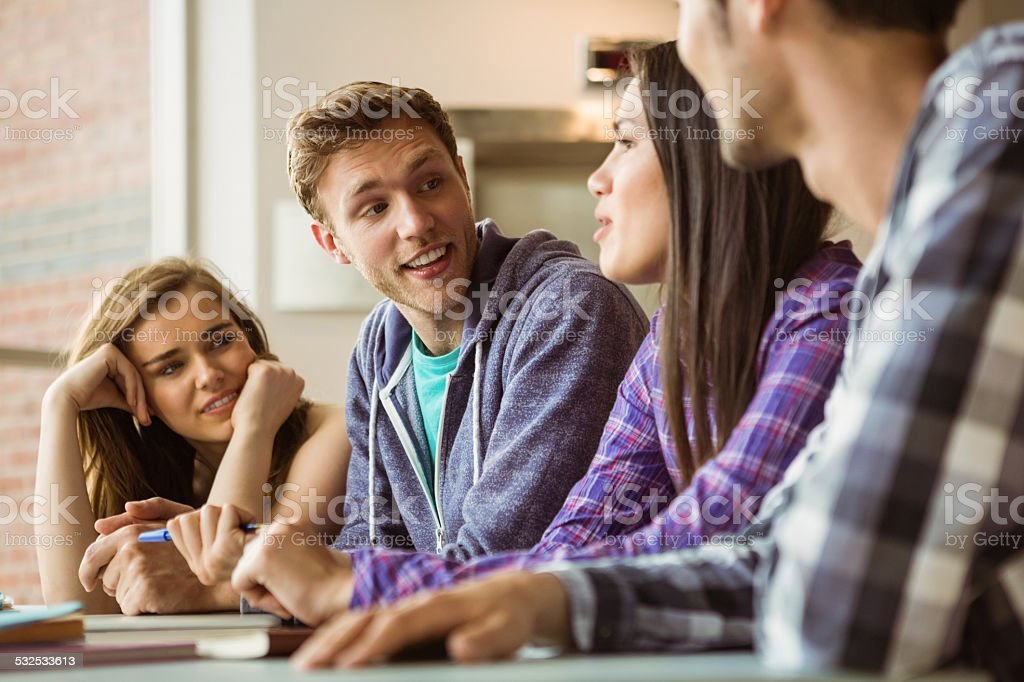 Smiling friends students talking together stock photo