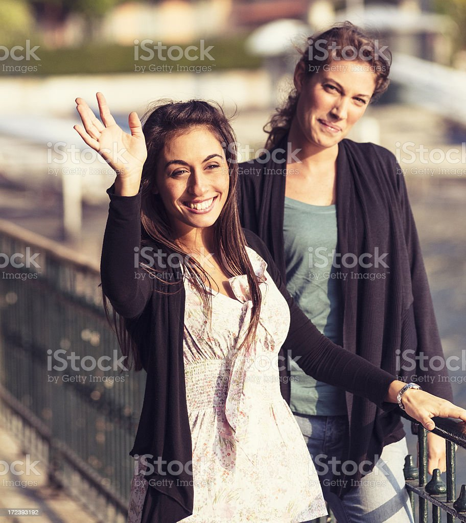 Smiling friendship waving hands royalty-free stock photo