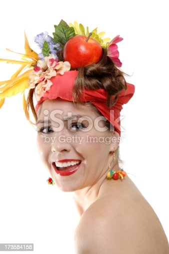 Women smiling wearing a fruit and flower headwrap