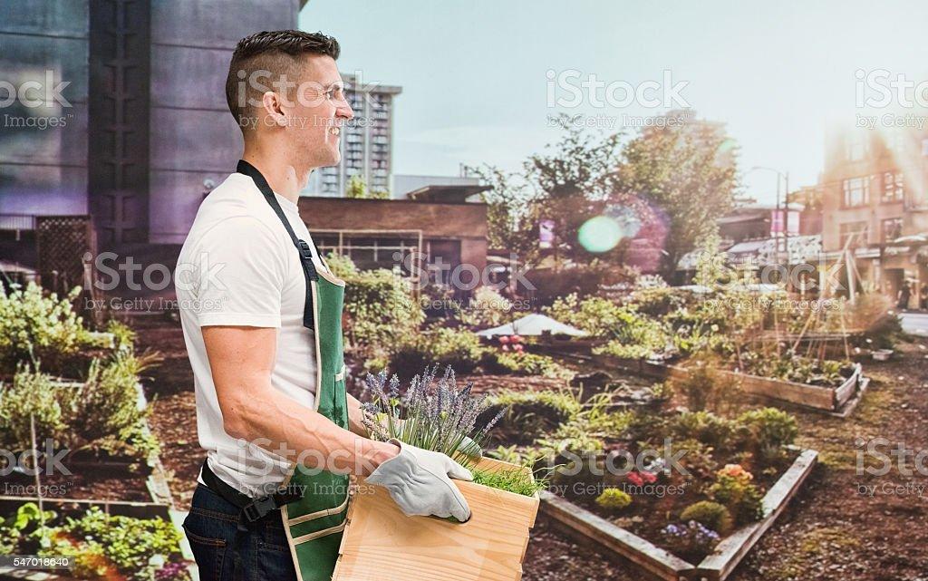 Smiling gardener holding box stock photo