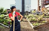istock Smiling gardener standing in garden 637354908