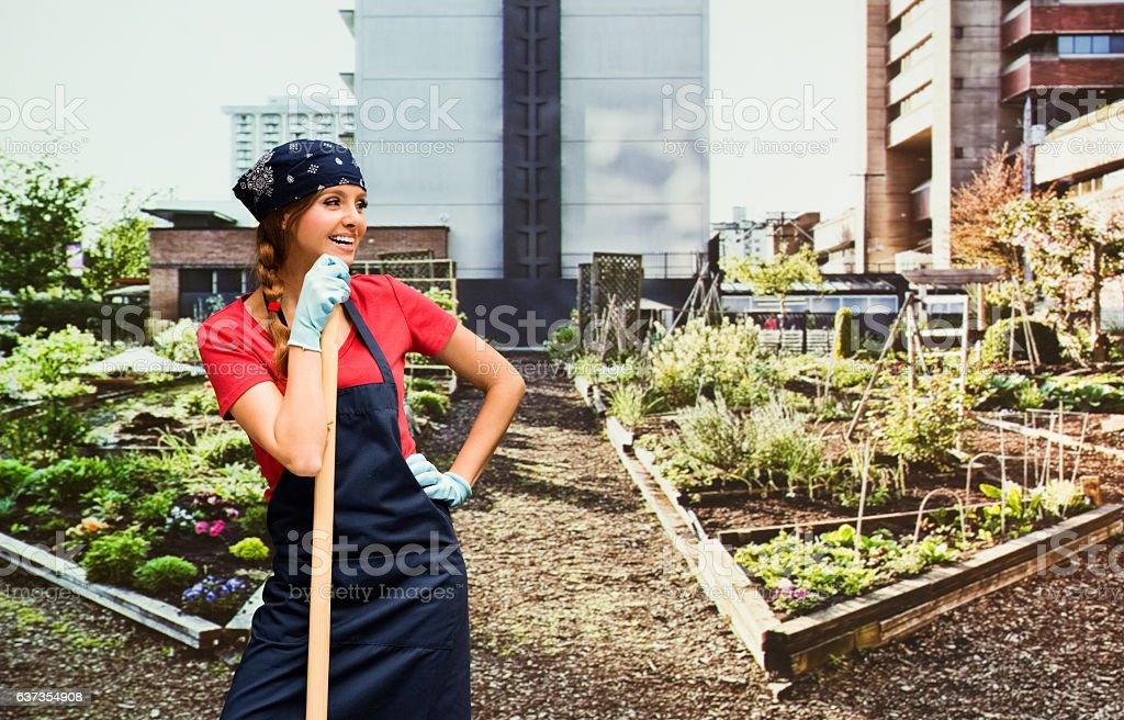Smiling gardener standing in garden stock photo