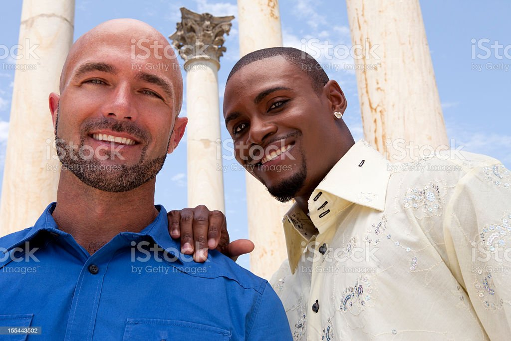 Smiling gay couple looks at the camera royalty-free stock photo