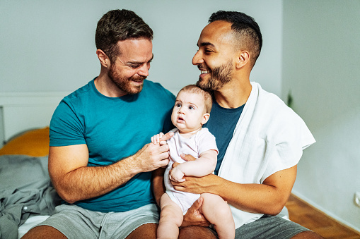 Gay couple adopted baby girl and enjoying the parenthood