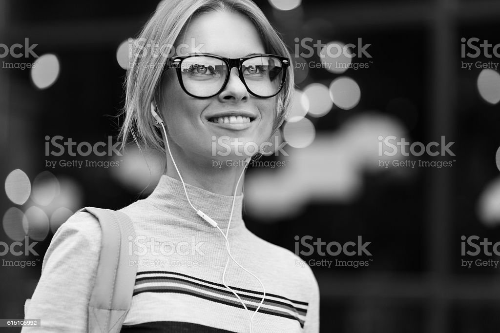 Smiling girl amid glass door black- white photo stock photo
