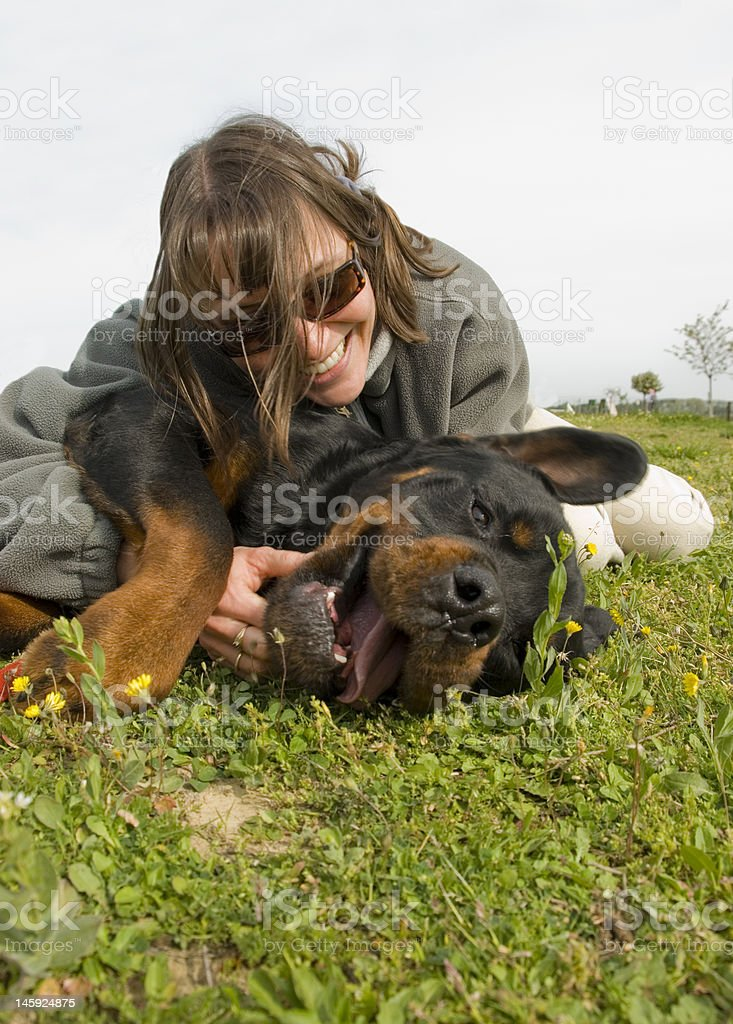 smiling girl and dog royalty-free stock photo