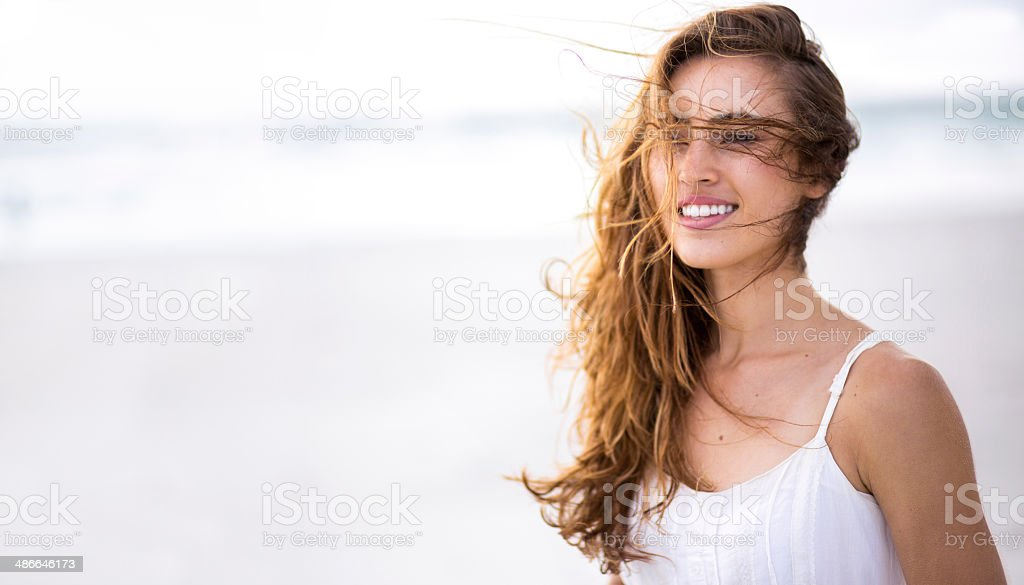 Smiling girl at beach with copy space stock photo